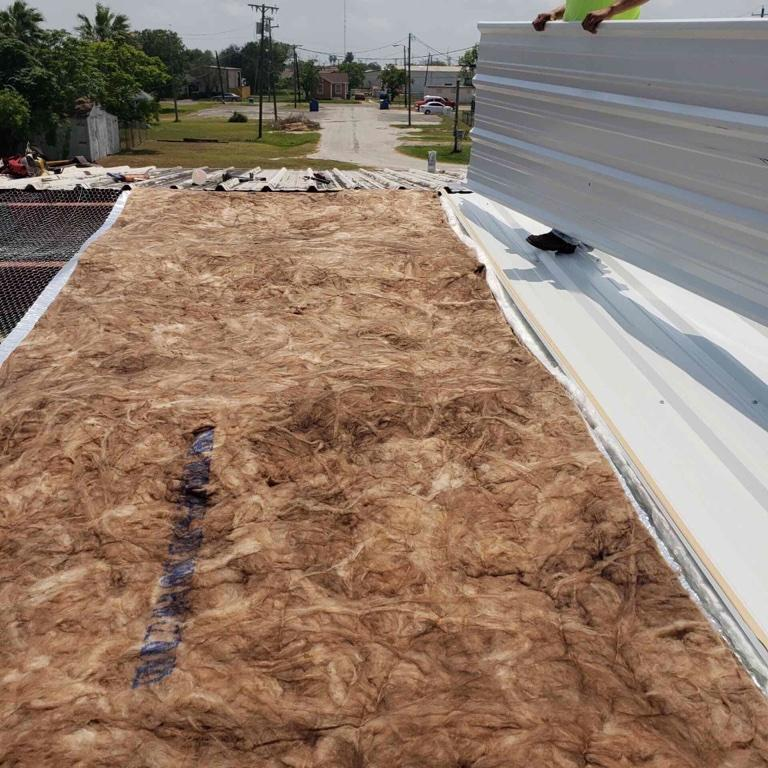 A picture of insulation and new roof panels being installed at the Senior Center.